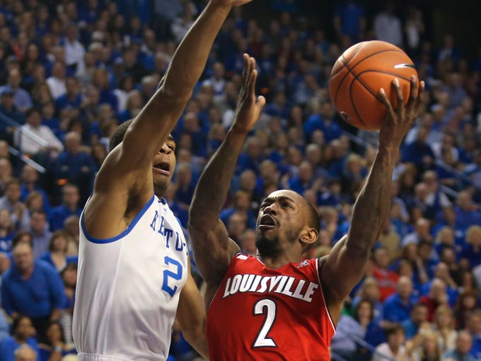 Louisville's Russ Smith (#2) goes up against Kentucky's Aaron Harrison to grab two. Dec. 28, 2013