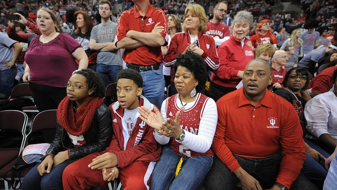 Indiana University basketball player Christian Watford's family travels many miles to see him play. Here his father Ernest, right, mother Belinda, brother Trendon and sister Elise, left, watch as the players warn up at half time of their game against Ohio State.