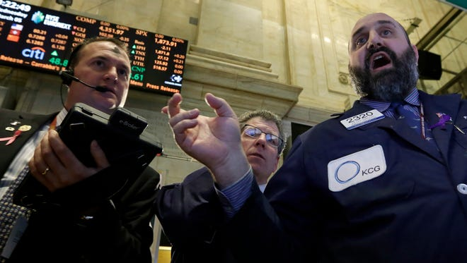 Traders work on the floor of the New York Stock Exchange on March 5.