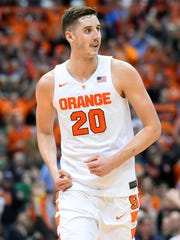 Syracuse's Tyler Lydon pumps his fists after making a basket against Notre Dame on Jan. 28 in Syracuse.