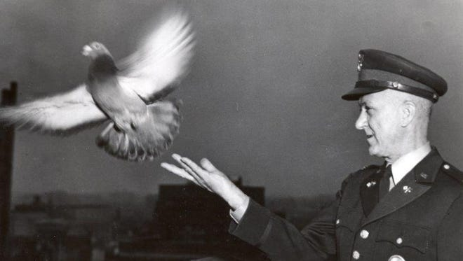 Colonel Clifford A. Poutre tossing the last bird in 1957 at the close-out of the U.S. Army Signal Corps Pigeon Service, Fort Monmouth.