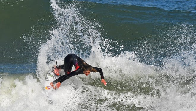 Practicing for the inaugural Florida Pro Surf competition that will be held at Sebastian Inlet. 15 year old Caroline Marks of Melbourne Beach is the youngest female to compete in a World Surf League Championship.