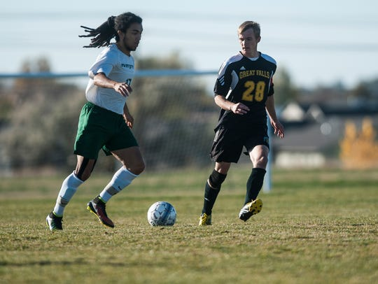 Evergreen State player Tanner Williams and UGF player