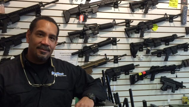 Steve Denny, owner of Carolina Guns & Gear, says sales of AR-15 rifles and other semi-automatic, military-style rifles remain brisk, although prices have dropped as panic buying has subsided.