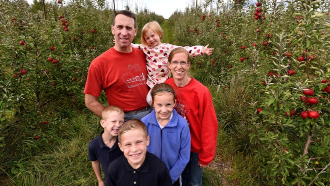 Steve and Bridget Tennes (pictured here with four of their five children) believe the city of East Lansing violated their First Amendment rights.