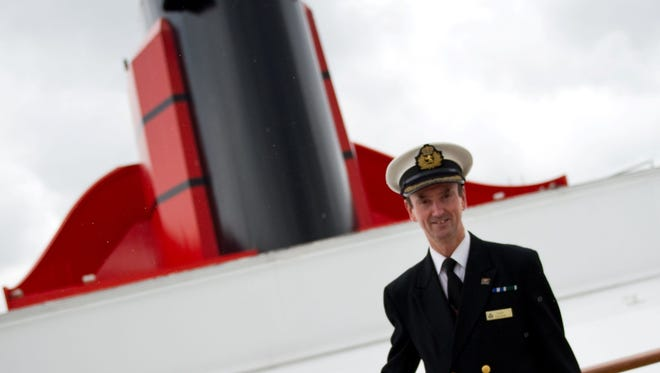 The captain of the Queen Mary 2, Christopher Wells, atop the vessel.
