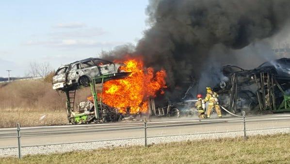 Semi hauling cars erupts into flames on I-70.