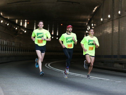 Running for the Santiago Sports Chiropractic team are professional runners (from left to right) are: Johnny Gregorek, Kyle Merber and Donn Cabral.
