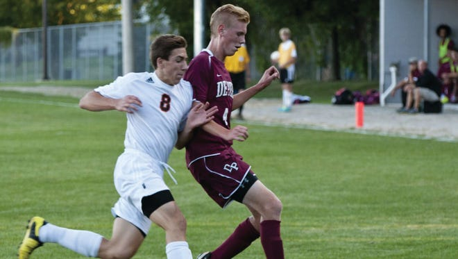 West De Pere High School senior midfielder Matt Lafrombois, left, battles De Pere High School senior midfielder/forward Brett Dvorak for possession of the soccer ball during the first half of the crosstown rivals' nonconference game in 2013.
