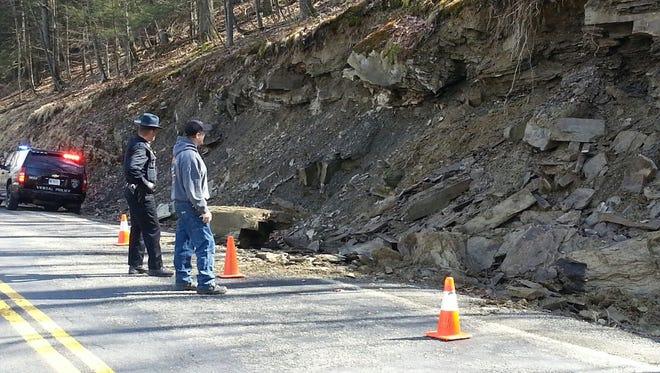 Vestal Police Officer Keith King and Deputy Highway Superintendent Craig Hiller at a rockslide Saturday on Pierce Hill Road in Vestal.