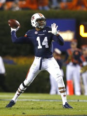 Auburn quarterback Nick Marshall (14) gets ready to unleash a pass.
