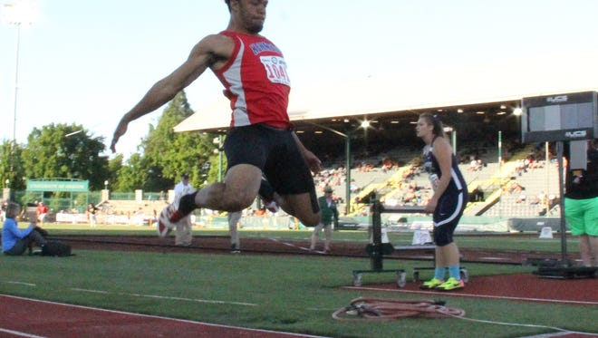 Kennedy senior Bishop Mitchell competes in the triple jump at the OSAA Class 2A state track and field meet at Hayward Field on Friday, May 19, 2017.