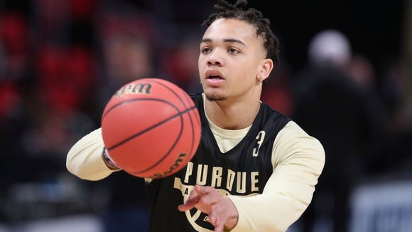 Purdue guard Carsen Edwards passes during a practice