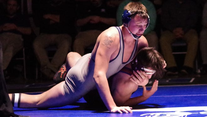 Sam Wilkins, the winner at 195 pounds, and Mount Anthony claimed the program's 30th straight team crown during Saturday's Vermont high school wrestling state championships at Otter Valley.