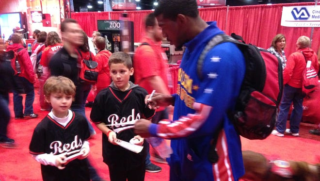 Harlem Globetrotter Buckets Blakes signs for young Reds fans at Redsfest.