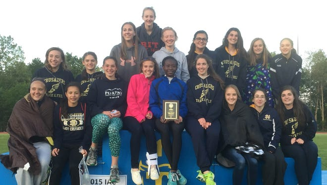 The Notre Dame girls track and field team with its trophy Friday after winning a third straight IAC Large School title.
