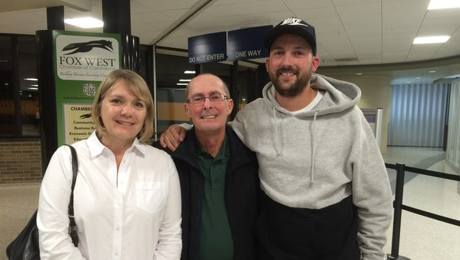 Nancy Moran, left, and Tim Moran, middle, finally meet Spencer Laird, the man who saved Tim's life.
