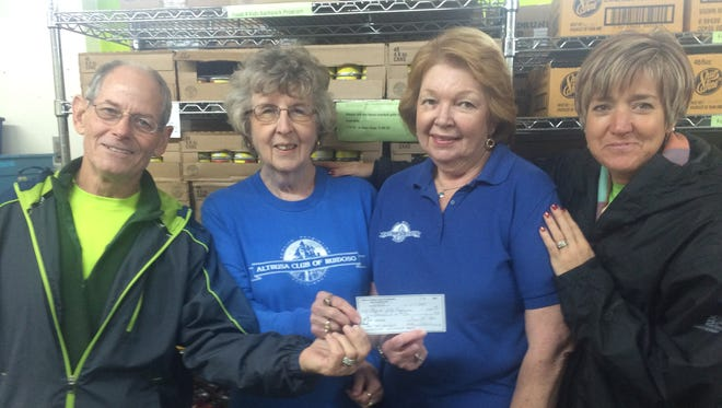 Altrusa of Ruidoso volunteers present a check for $2000 to Food for Kids .
