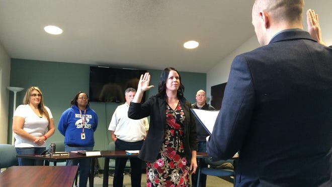Mayor Dave Snow swears in Denise Retz as parks superintendent Friday as Parks and Recreation Board members Deanna Beaman, Tiauna Washington, Mike Foley and Clay Miller watch.