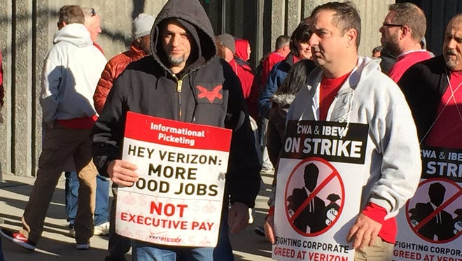 Striking Verizon workers picket outside the Verizon building at 111 Main St. in White Plains, across from the Galleria, April 13, 2016.