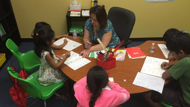 Owner Nina Vukovic teaches at the JEI Learning Center in Hamilton Township. Vukovic said she is happy to be profiting from teaching children after school and on weekends.