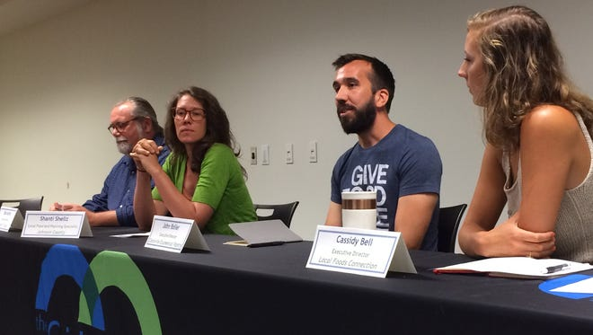 Table to Table Director Bob Andrlik, Johnson County Local Food Specialist Shanti Sellz, Coralville Food Pantry Director John Boller and Iowa City Farmers Market Manager Cassidy Bell speak at a panel on healthy foods at the Johnson County Hunger Forum on Tuesday.