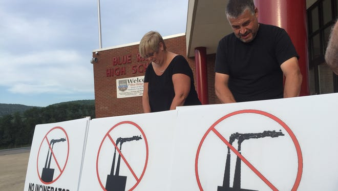 Sue and Joe Pipitone of New Milford Township collect signatures in opposition of the opposed industrial incinerator in Susquehanna County, Pa. before an Aug. 16, 2016 informational meeting on the project conducted by the League of Women Voters.