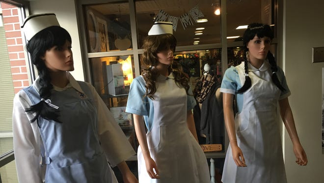 Mannequins in the Deaconess Hospital lobby model some of the nursing uniforms used during the hospital's 125 years.