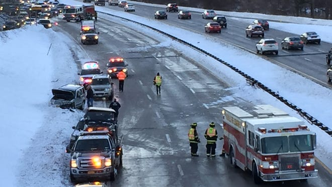 Emergency crews respond to a crash on the northbound Sprain Brook Parkway, just south of the Hospital Road overpass in Hawthorne, Friday, Feb. 10, 2017. Traffic was being diverted off the Parkway onto Hospital Road.