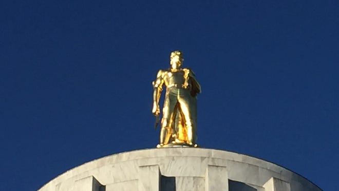 Sun cast early morning light on the Golden Pioneer on the Oregon Capitol
