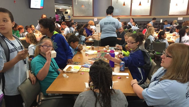 Third Grade Academy students eat breakfast Friday at Reid Health's Cafe at Twelve Hundred.