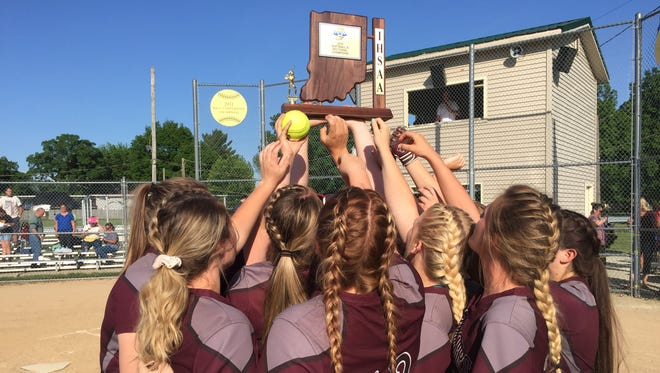 Wes-Del players hold the trophy after defeating Liberty Christian for the sectional title at Daleville High School on Thursday, May 24, 2018.