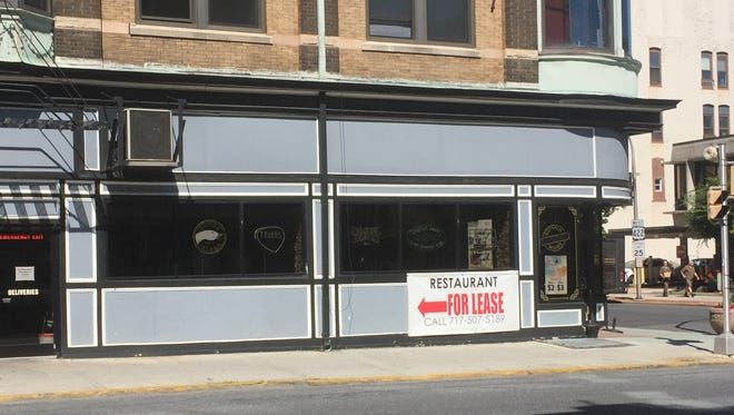 Signs advertising the first-floor restaurant inside the Samler Building was available for lease appeared in mid-June.