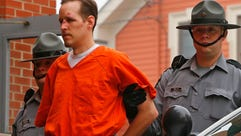 Police escort Eric Frein into the Pike County Courthouse