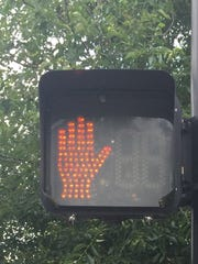 "It is illegal to enter a crosswalk against the ""Don't Walk"" sign, even if no traffic is coming."