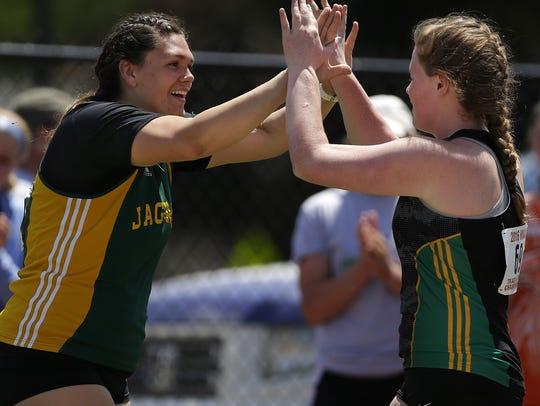 Ashwaubenon's Kris Lindow congratulates teammate Erin