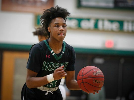 Des Moines North junior point guard Tyreke Locure sizes