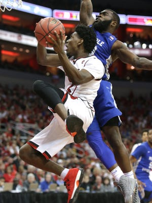 Louisville's Darius Perry drives to the basket against MTSU's Giddy Potts. March 18, 2018.