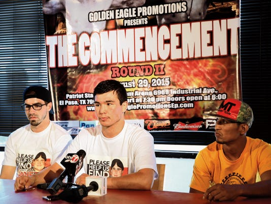 El Paso boxer Abie Han, center, listens to a question from a reporter at a news conference Thursday on his Aug. 29 scheduled fight at Patriot Stadium.
