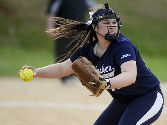 Dallastown pitcher Jaelynn Harbold prepares to throw to first base for an out during a softball game at Dallastown Area High School on April 15.