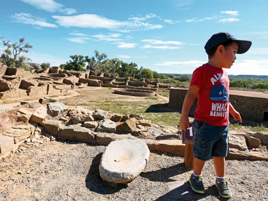 Jonah Ash, 2, of Bloomfield, looks around at the last stop of a self-guided tour of Aztec Ruins National Monument on Monday.
