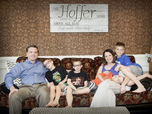 Chris and Sheíla Hoffer pose with their four boys at their home in Palmyra. Sheíla Hoffer may have had Lyme disease for years before conceiving her children, who each suffer from complications of the disease after acquiring it in utero.