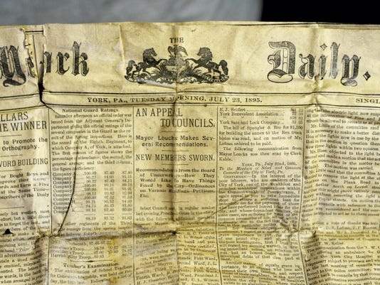 The July 23, 1895, edition of the York Daily newspaper is shown at Guitars on George on Friday, Aug. 21, 2015. The pastor of Iglesia de Dios, Efrain Reyes, took the box to North York borough mayer Jerry Duncan to determine whether any of the contents were valuable or useful.
