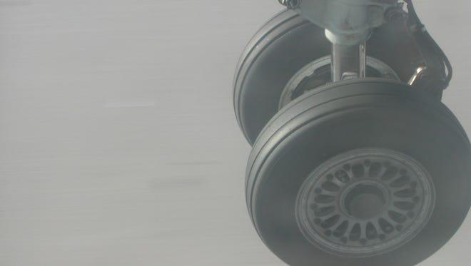 File photo: Airplane landing gear wheels.