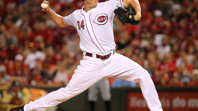 Cincinnati Reds starting pitcher Homer Bailey (34) delivers in the fifth inning during the National League baseball game between the Miami Marlins and the Cincinnati Reds, Friday, July 21, 2017, at Great American Ball Park in Cincinnati.