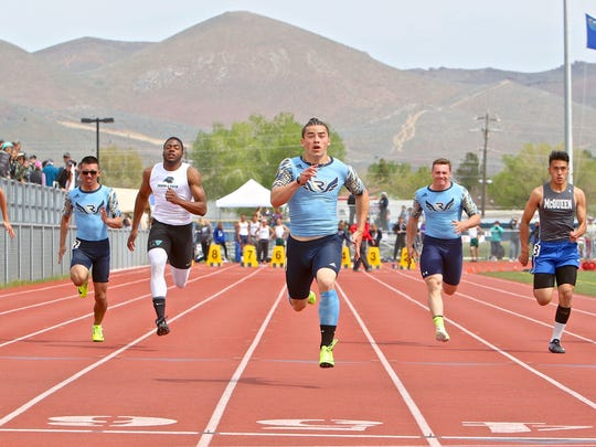 Bobby Widmar, center, lowered his time in the 100-meter dash to 10.63 seconds in the league championship meet at Carson.