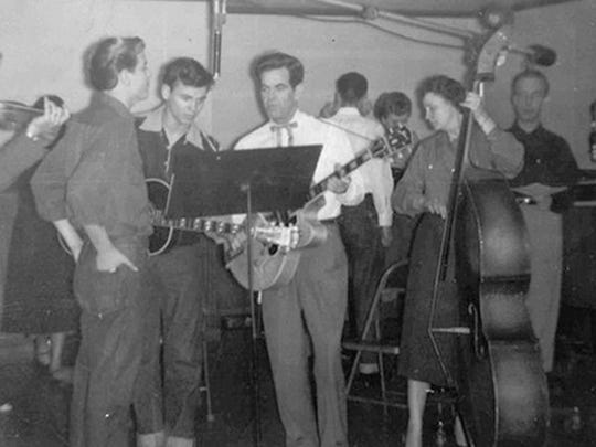 The Everly brothers, Phil, left, and Don, perform on the Cas Walker Show on March 8, 1954, with parents, Ike and Margaret.