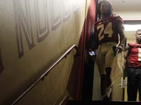 Florida State University quarterback Everett Golson descends the stairs at Doak Campbell Stadium Sunday during the team's annual media day event.