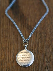 One of Natalie Bajandas favorite things is this pendant with an Apache blessing inscripted.