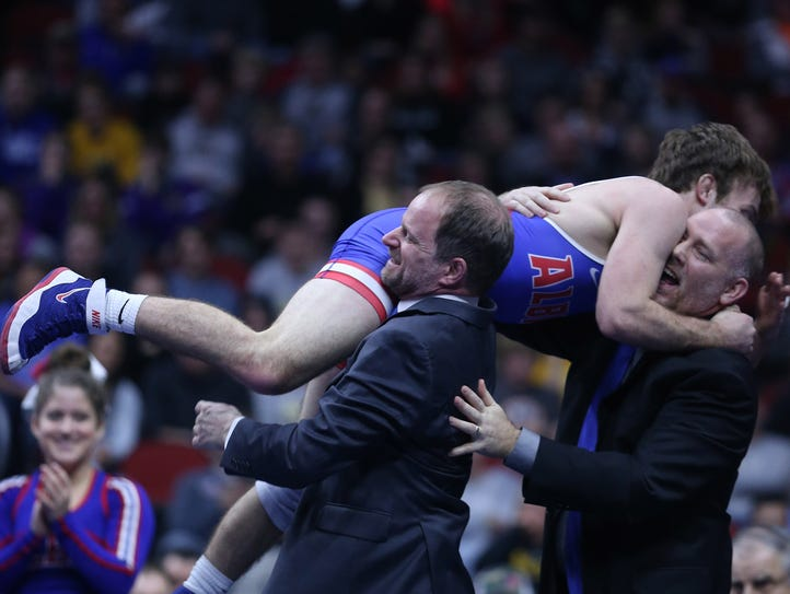 Albia's Aden Reeveshis celebrates with his coaches